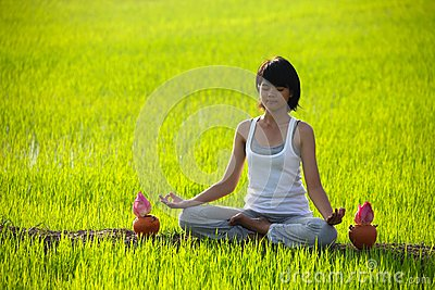 Girl practicing yoga,sitting with lotus flower