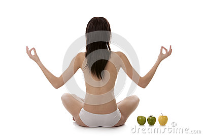 Girl practicing yoga on white