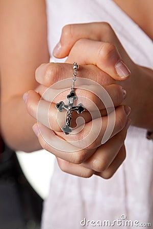 tattoos of praying hands with cross. cross tattoopraying hands,