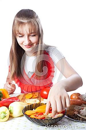 Girl prepares salads