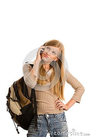 Girl preparing to school using cell phone
