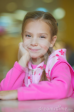 Girl-preschooler sitting at table