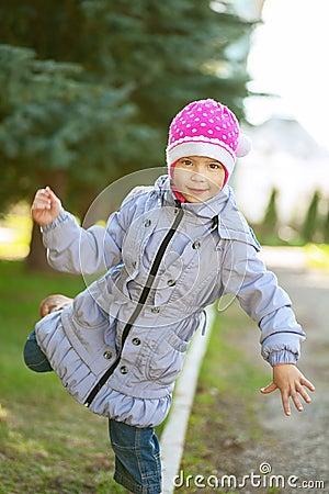 Girl-preschooler walking on curb