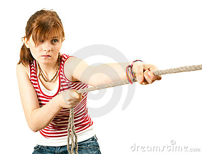 Girl pulling grey rope, tug-of-war