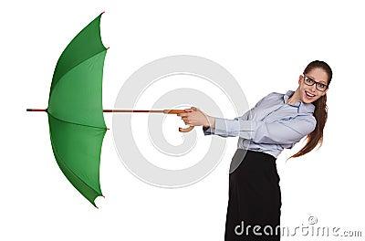 Girl pulls to itself open umbrella
