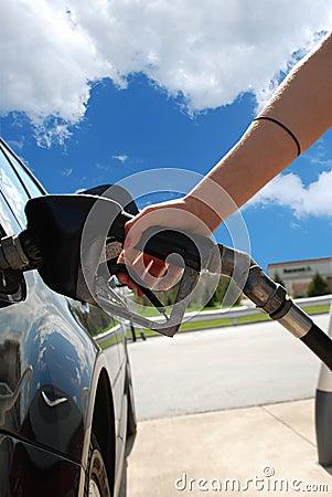 Free Girl Pumping Gas Stock Image - 2193661