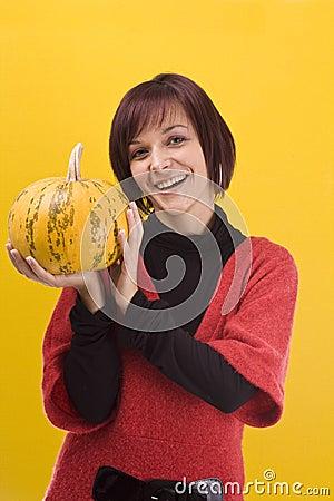 Girl and pumpkin