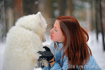 Girl with a puppy Samoyed