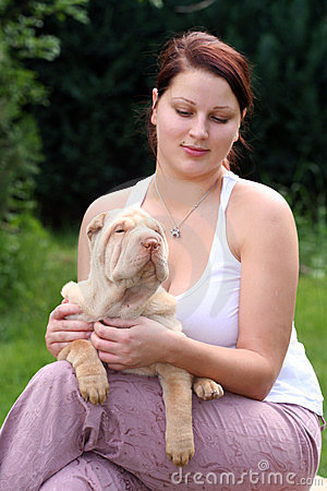 Girl with a puppy sharpei