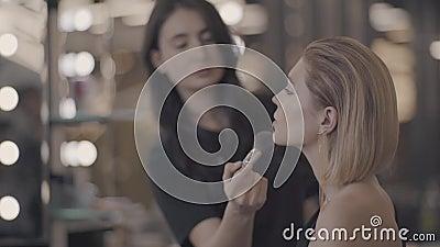 Girl put on the makeup.  stock footage