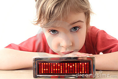 Girl puts chin on hands and electronic panel