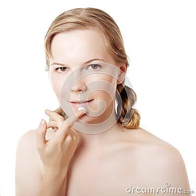 Girl puts on skin cream