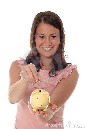 Free Girl Putting Coin In Piggy Bank Royalty Free Stock Photos - 889018
