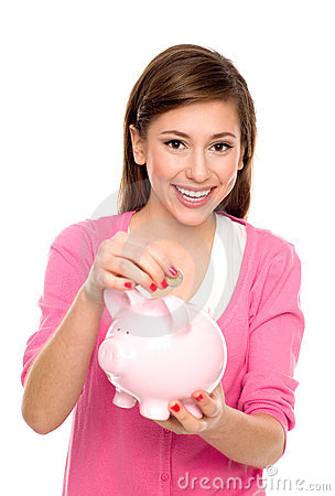 Girl putting coin in piggy bank