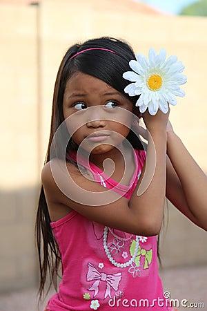 Girl Putting Daisy Flower In Hair