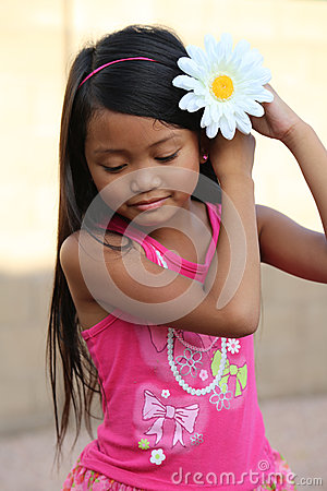 Girl Putting Flower In Hair