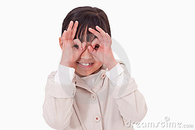 Girl putting her fingers around her eyes