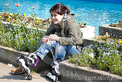 Girl putting on rollerblades