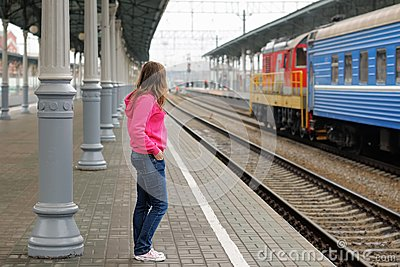 Girl on railway station platform