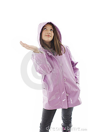Girl in a raincoat checks to see if it is raining