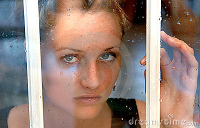 Girl in rainy window