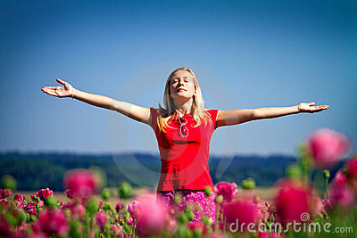 Girl with raised arms outdoors