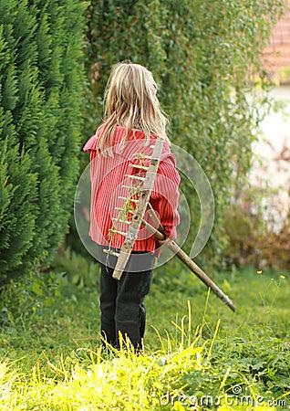 Girl with rake