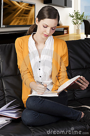 The girl reading a book with absorbed axpression
