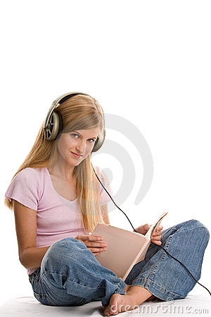 Free Girl Reading Book And Listening To Music Stock Image - 11021721