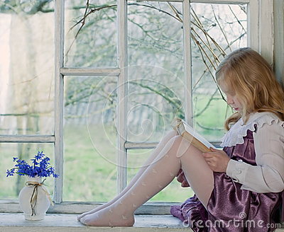 Girl reading book indoor
