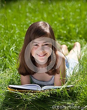 Girl reading book outdoor