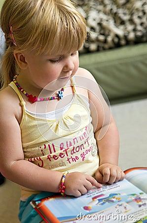Girl reading children book