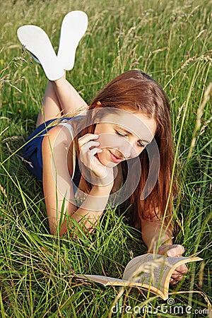 Girl Reading in long grass