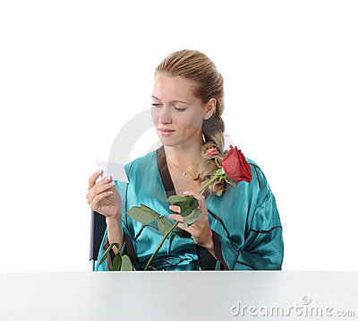 Girl reading a love note.