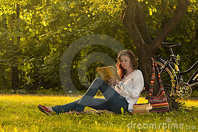Girl reading in park