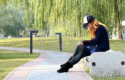 Girl reading in park..