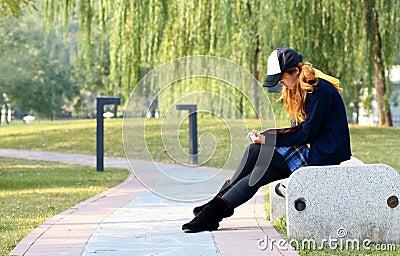 Girl reading in park..