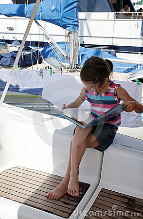 Girl reading on yacht