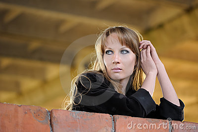Girl recline on wall