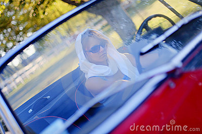 Girl and red cabriolet