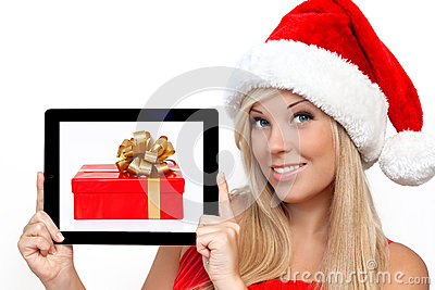 Girl in a red Christmas hat holding tablet