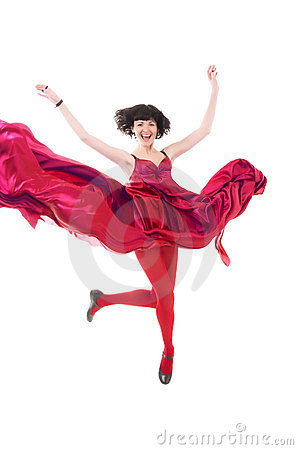 Girl in red dress flying in a jump