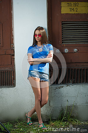 Girl in red glasses and blue shirt