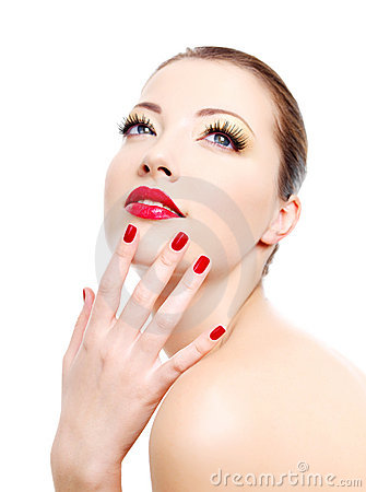 Girl with red gloss manicure and sexy lips