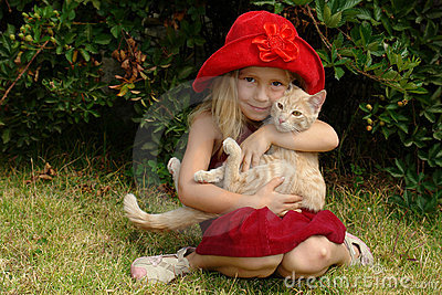 The girl in red hat with cat