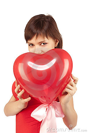 Girl with red heart balloon