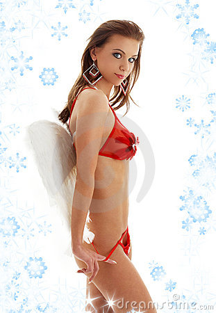 Girl in red lingerie with angel wings and snowflak