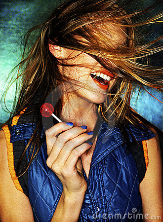 Girl with red lollipop and hair