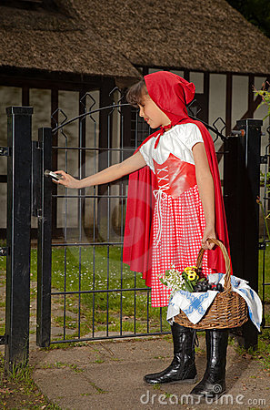 Girl In Red Opening Gate Royalty Free Stock Image - Image: 10105606