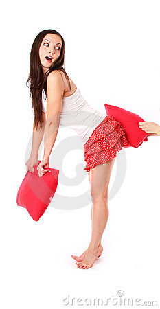 Girl in red with pillow